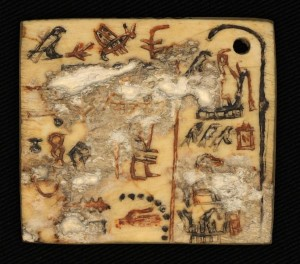 Ivory funerary label inscribed with early Egyptian hieroglyphs. 1st Dynasty (c.2900BCE)   Photo: Kathryn Piquette courtesy Trustees of the British Museum.